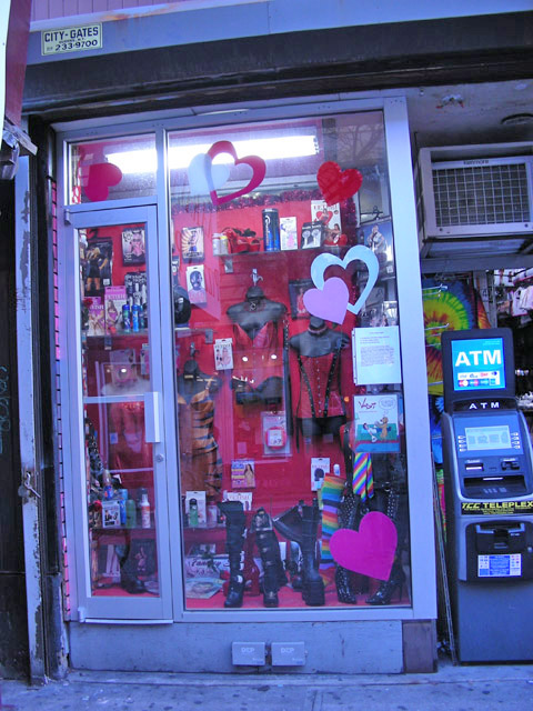 storefront with manniquins and red hearts