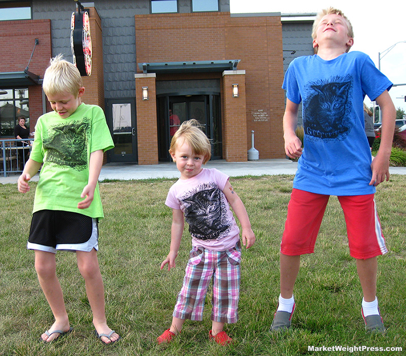 3 kids dance with their GrrrKitty t-shirts on