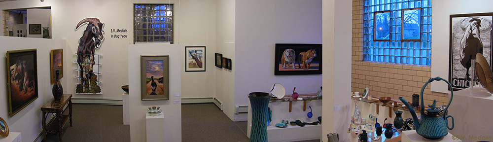 panoramic view of gallery featuring 8ft goat, 6ft chicen and various paintings and relief prints