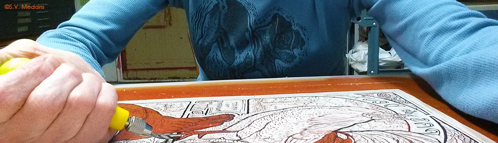 artist carves chickens in lino block (Pas de Deux) with gouge tool