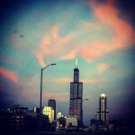 colorful sky behind skyscraper in Chicago, Ill